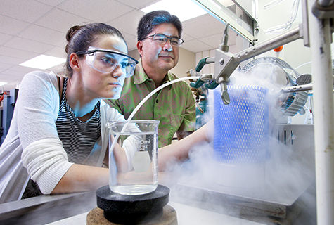 Professor Stanton Ching and a student performing a chemistry experiment.