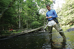 Douglas Thompson, associate professor of geology, likes to get his feet wet