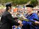 Seniors begin to receive their diplomas.<em><span style=font-size:9pt;>&nbsp;Credit: Jon Crispin</span></em>