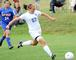 Olivia Gerde &#39;10 goes for the goal.<em><span style=font-size:9pt;>&nbsp;Credit: John Narewski</span></em>