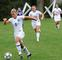 Kate Driscoll &#39;12 leads the way down the soccer field.<em><span style=font-size:9pt;>&nbsp;Credit: John Narewski</span></em>