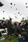 The graduates toss their hats into the air.<em><span style=font-size:9pt;>&nbsp;Credit: Brandon W. Mosley</span></em>