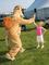 The Camel gives a young girl a high five.<em><span style=font-size:9pt;>&nbsp;Credit: Ron Cowie</span></em>