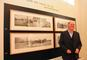 Professor Ted Hendrickson poses with his photos of New London, part of a display at the adjacent Provenance Center.