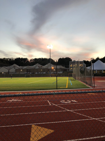 A photo of the Connecticut College track at sunset