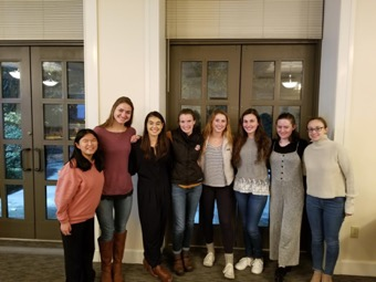 Lexi poses with seven girl friends at the Sophomore Leadership Dinner