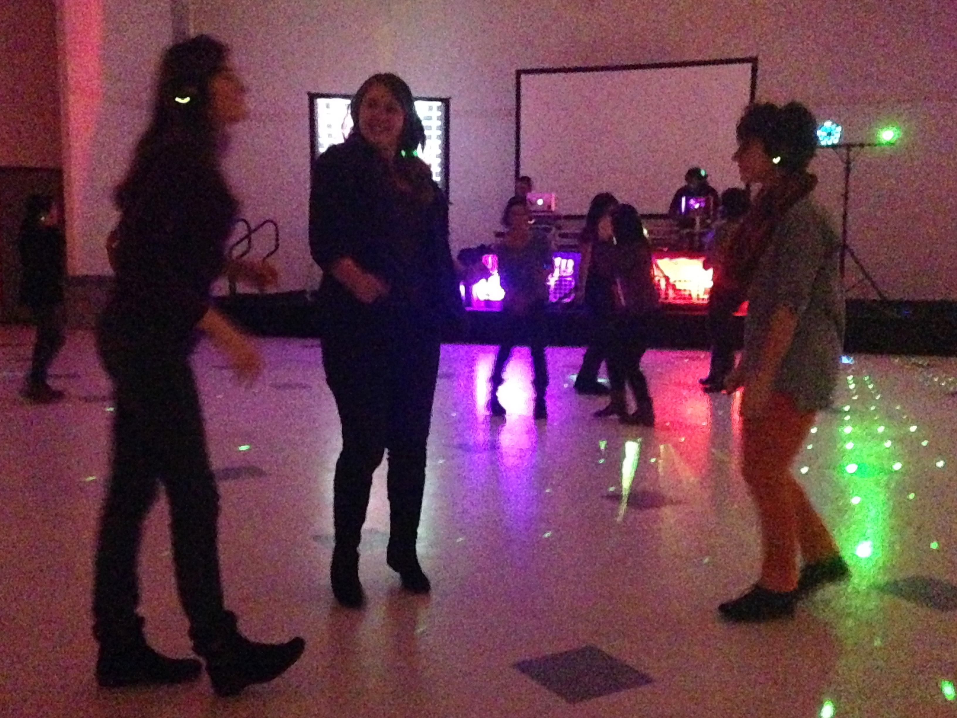 Photo of students dancing at headphone-less disco