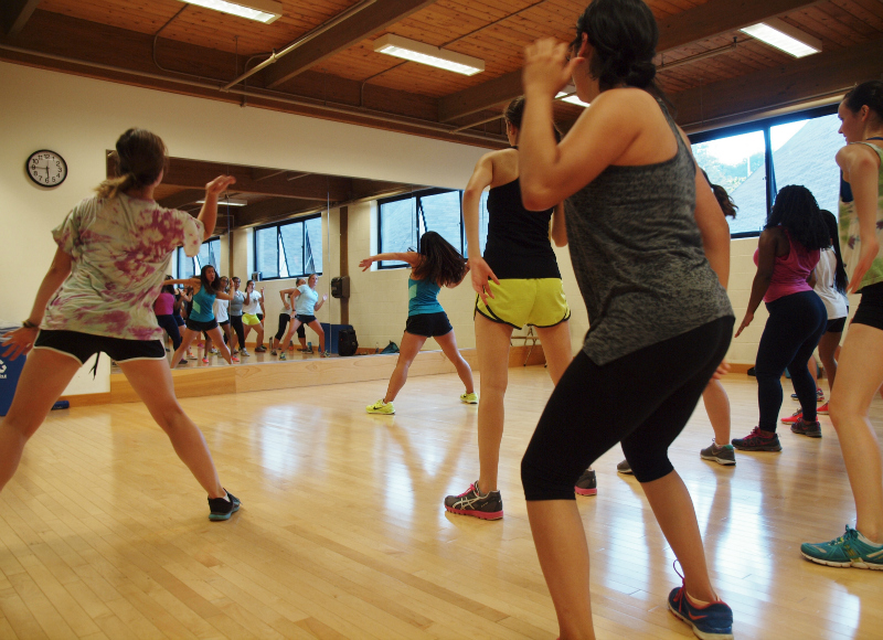 Working out at dance fitness class