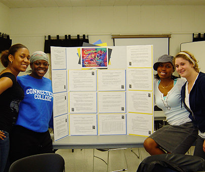Human Development students with their project board presentation.