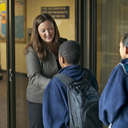 Principal Stephanie-Lee Morgan '04 greets students at Excel Academy Charter School in Chelsea, Mass.