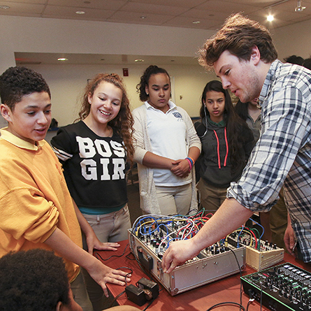 Ned Rogers '16 leads a music technology workshop on the Connecticut College campus for students from Bennie Dover Jackson Middle School in New London, Connecticut.