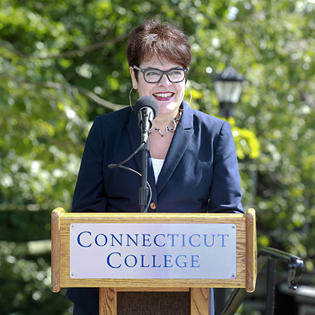 President Katherine Bergeron speaks at a ribbon-cutting ceremony marking the official reopening of Unity House and the completion of a road extension project that connects the north and west parts of campus.