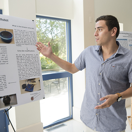 George Tilneac '18 describes his work with Jaleel Watler '19 to develop an autonomous double robot. Tilneac and Watler worked with computer science professors Gary Parker and James Lee on the research.