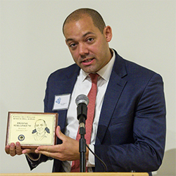 Dwayne Stallings '99 accepts his induction in the Connecticut College Athletic Hall of Fame