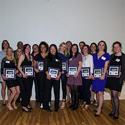 Members of the 1998 Women's Soccer team pose with plaques honoring their induction into the Athletic Hall of Fame
