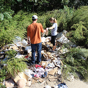 Corbin Maynard '17 and Avery Thomas '16 record a large assemblage of personal possessions discarded in an empty lot.