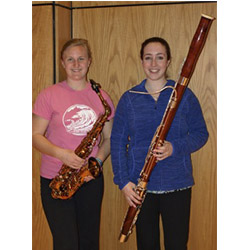 Emily Verschoor-Kirss '15 (left) and Avery Yurman '13 pose with their instruments. The two recently participated in the New England Intercollegiate Band Festival at Gordon College.