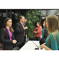 Caitlyn Turgeon '08 (left), human capital consultant at Deloitte Federal Consulting, spoke with students after a panel discussion during the recent