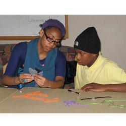 Marline Johnson '13 and a student work on an art project as part of ENRICH, the College's new extended learning time program for students at New London's Bennie Dover Jackson Middle School.