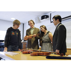 Luthier Karl Dennis (second from left) shows early and modern string instruments in his collection to Jesse Guterman '16, Kelly D'Ancicco '16 and Professor Daniel Lee. Photo by Laura Cianciolo '16.
