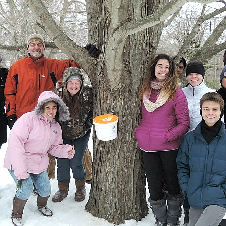 Grounds supervisor Jim Luce holds a maple syrup-making workshop.