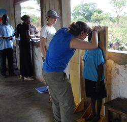 Brigid O'Gorman '11 records a child's height at the Asayo's Wish Orphanage in Kaberamaido, Uganda, <br>in 2009.<br><br>