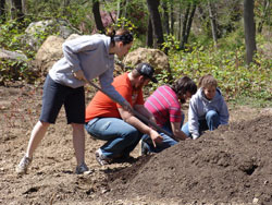 Students tend to the College's organic garden.